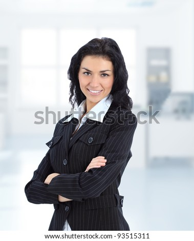 Young brunette business woman in her office - stock photo