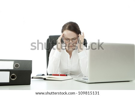 young brunette business woman with glasses has headache on desk
