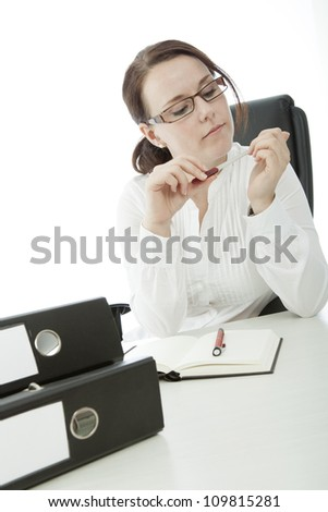 young brunette businesswoman with glasses file nail