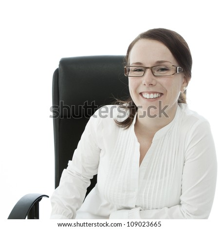 young brunette businesswoman with glasses smiling - stock photo