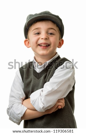 Young brunette caucasian boy smiling with arms crossed wearing flat cap - stock photo