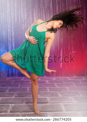 Young brunette caucasian woman dancing - stock photo