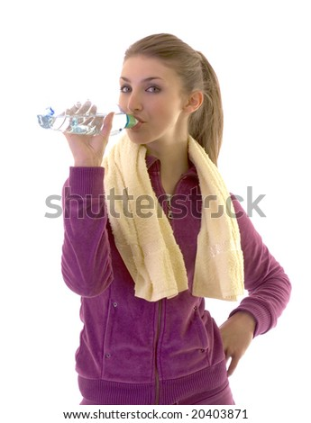 Young brunette girl drink water after exercising