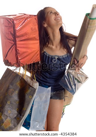 Young brunette girl holding bags and gifts after shopping