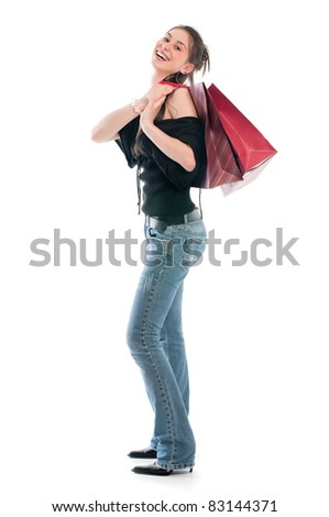 Young brunette girl holding bags and presents after shopping - stock photo
