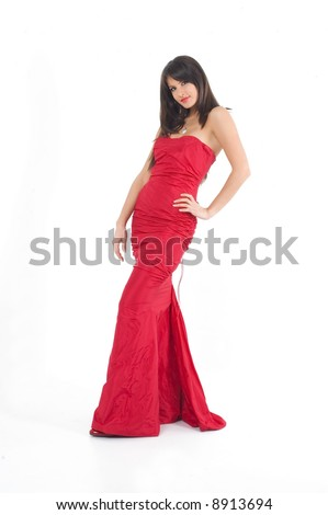 Young brunette girl in fashionable sexy red dress.