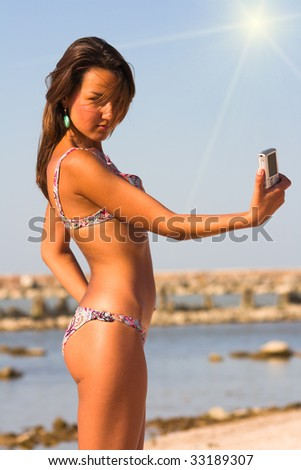 young brunette girl on a beach