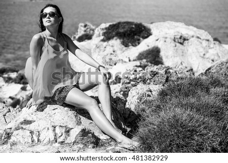 Young brunette girl relaxing near outdoor near sea