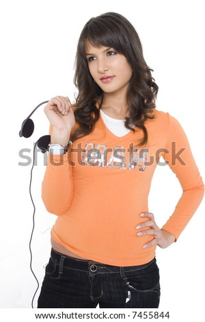 Young brunette girl with headphones listening music.