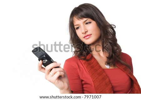 Young brunette girl with mobile phone in hand. - stock photo