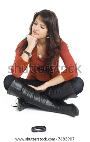 Young brunette girl with mobile phone waiting a call.