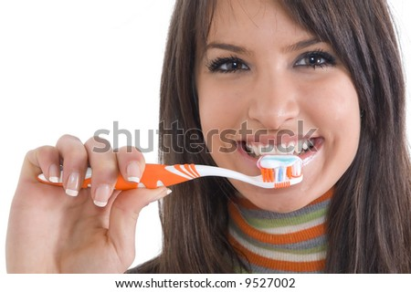Young brunette girl with tooth brush in hand. Concept of tooth care and oral hygiene. - stock photo