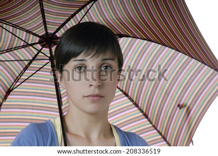 young brunette girl with umbrella, studio picture - stock photo