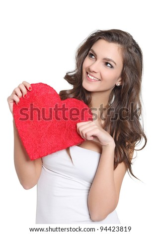 Young brunette holding a big love sign - stock photo
