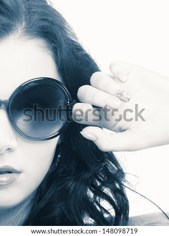 Young brunette in big sunglasses. - stock photo