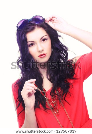 Young brunette in red dress with big sunglasses. - stock photo