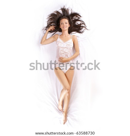 Young brunette in sexy lingerie - stock photo