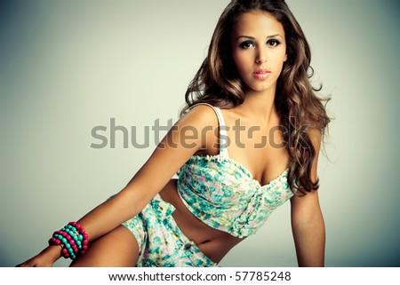 young brunette in summer clothes, studio shot - stock photo