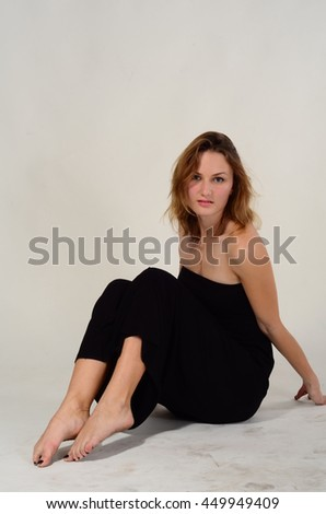 Young brunette lady in black dress posing - stock photo