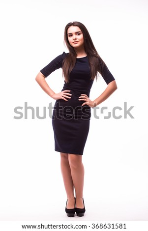 Young brunette lady in black dress posing on white background