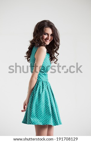 Young brunette lady in color dress. Fashion portrait. Sexy beautyful dress - stock photo