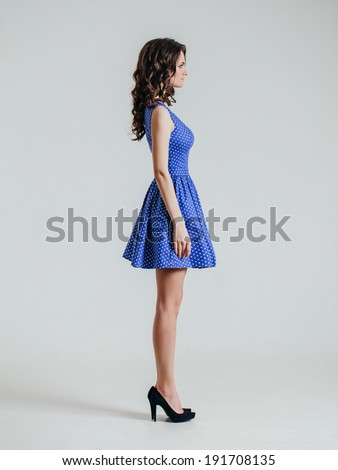 Young brunette lady in color dress. Sexy beautyful dress - stock photo