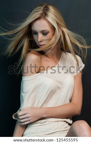 Young brunette lady posing on gray background - stock photo
