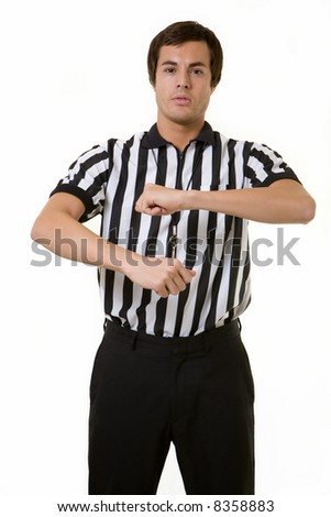 Young brunette man wearing a referee striped black and white top holding a basketball