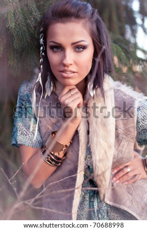 Young brunette posing in the forest - stock photo