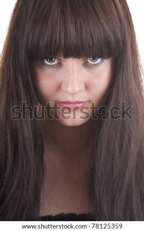 Young brunette serious woman portrait - stock photo