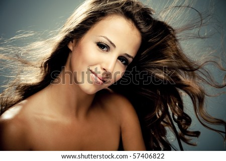 young brunette smiling woman, studio shot