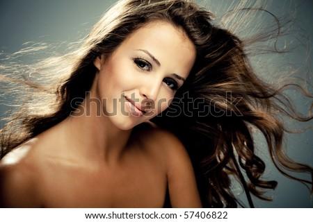 young brunette smiling woman, studio shot - stock photo