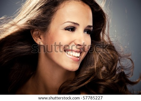 young brunette smiling woman, studio shot - stock photo