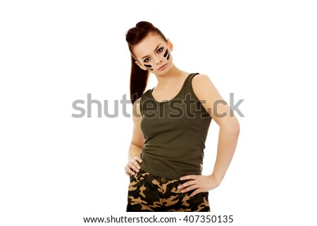 Young brunette soldier serious woman  - stock photo