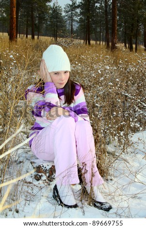 Young brunette teen in the field after the snowfall