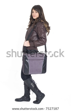 Young brunette teenager girl with laptop bag on white background.