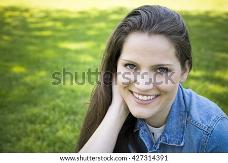 young brunette wearing summer outfit outdoors - stock photo