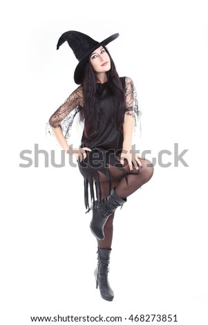 Young brunette witch isolated on a white