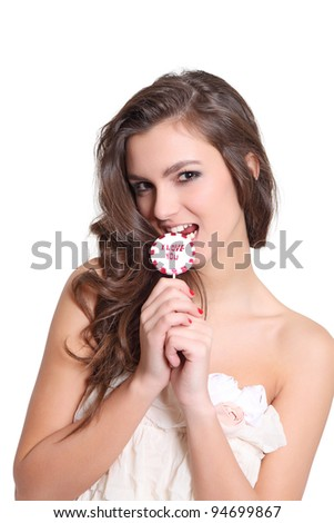 Young brunette with a lollipop - stock photo