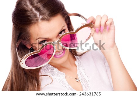 Young brunette with big heart-shaped sunglasses - stock photo