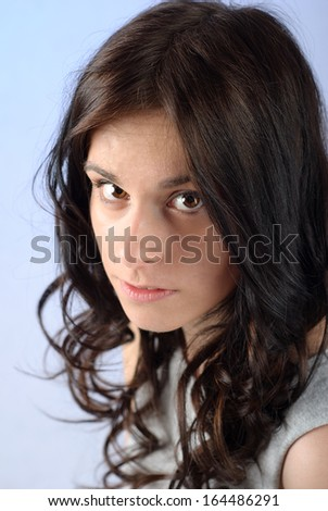 Young brunette with brown eyes - stock photo