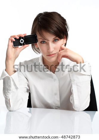 young brunette with cellphone, upset and sad. on white background - stock photo