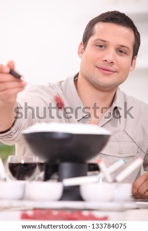 Young brunette with fondue - stock photo