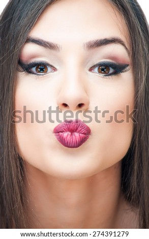 Young brunette with kissable lips - stock photo