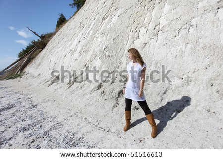 Young brunette woman at the chalk cliffs of ¼gen - stock photo
