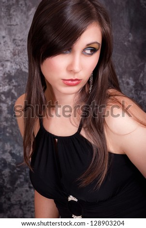 Young brunette woman beauty portrait. Beauty studio shot
