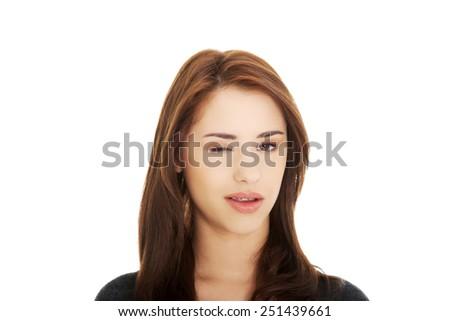 Young brunette woman blink eye - stock photo