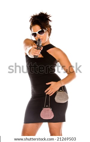Young brunette woman dressed to kill in a black mini dress. Carrying two small purses and a handgun