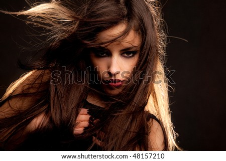young brunette woman, flying hair - stock photo
