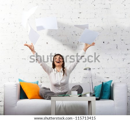 Young brunette woman has a minute to relax working at home - stock photo